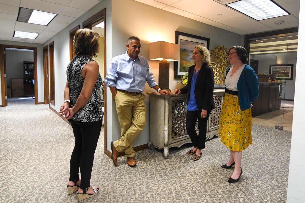 Staff gathered around front desk