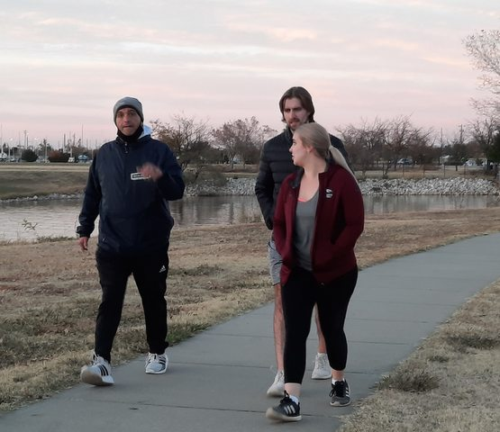 3 people walking on Lake Hefner Trail